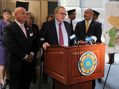 Announcing a system of changes to dramatically reshape the Philadelphia courts are Chief Justice Ronald D. Castille (center), Justice Seamus McCaffery (left), and Philadelphia District Attorney Seth Williams. (Laurence Kesterson / Staff Photographer)