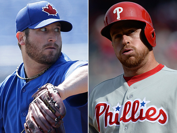 The Phillies traded catcher Erik Kratz (right) and left-handed pitcher Rob Rasmussen (not pictured) to the Blue Jays for right-handed pitcher Brad Lincoln (left). (AP file photos)