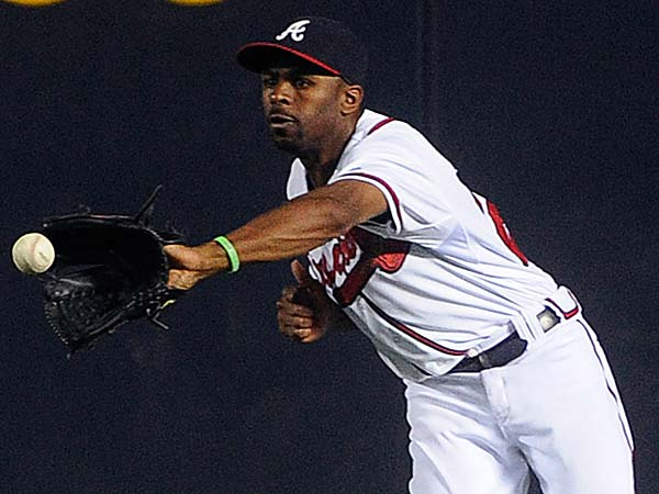 Scott Boras still expects Michael Bourn to get more than the 5 years, $75.25 million that B.J. Upton received from Atlanta. (John Amis/AP file photo)