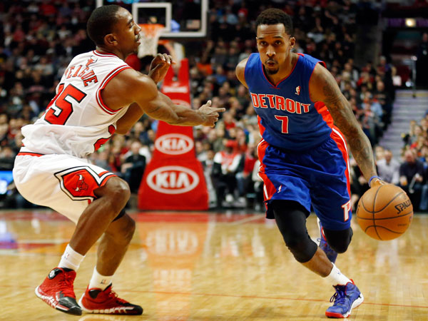 Detroit Pistons guard Brandon Jennings, right, drives to the basket against Chicago Bulls guard Marquis Teague, left, during the second half of an NBA basketball game in Chicago, Saturday, Dec. 7, 2013. The Pistons won 92-75. (Kamil Krzaczynski/AP)