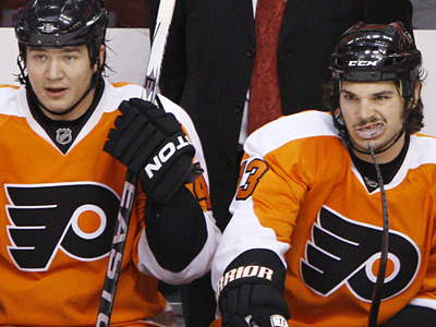 Arron Asham, left, and Daniel Carcillo watch from the bench during the yesterday´s loss. Carcillo had been suspended 4 games by the NHL. (AP Photo/Matt Slocum)