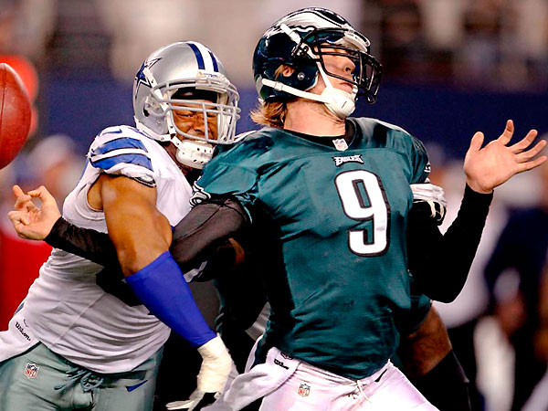 Nick Foles is hit from behind by Dallas´ Victor Butler during the Eagles´ 38-33 loss Sunday night that dropped their record to 3-9. (Ron Cortes/Staff Photographer)
