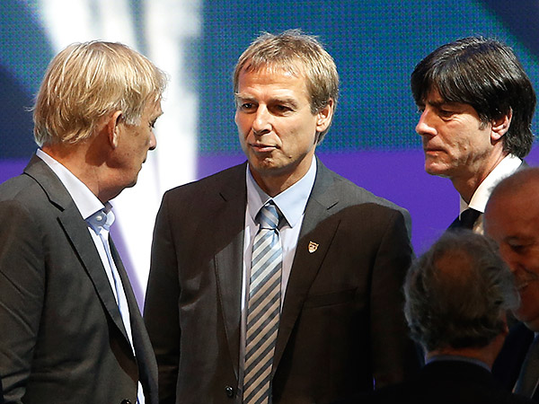 U.S. national team coach Jurgen Klinsmann (center) will be under pressure to pull the United States out of a tough World Cup group stage draw. (Silvia Izquierdo/AP)