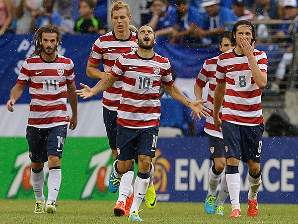 Landon Donovan of the USA (center) reacts after scoring a goal against El Salvador during the quarterfinals of the CONCACAF Gold Cup. (Patrick Semansky / AP)