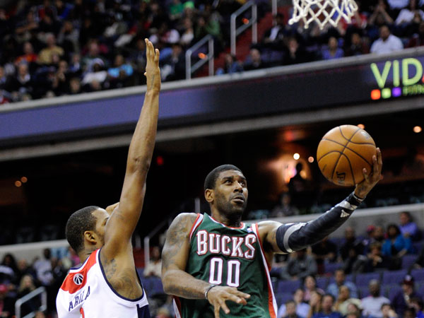 Milwaukee Bucks guard O.J. Mayo (00) goes to the basket against Washington Wizards forward Trevor Ariza (1) during the first half of an NBA basketball game, Friday, Dec. 6, 2013, in Washington. The Bucks won 109-105 in overtime. (Nick Wass/AP)
