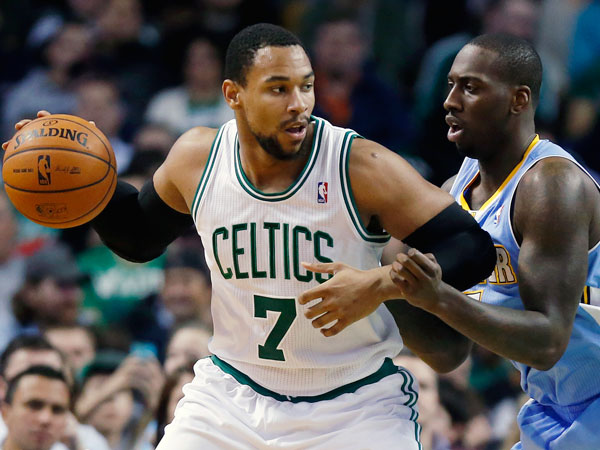 The Nuggets´ J.J. Hickson, right, defends against Boston Celtics´ Jared Sullinger (7) in the second quarter of an NBA basketball game in Boston, Friday, Dec. 6, 2013. (Michael Dwyer/AP)