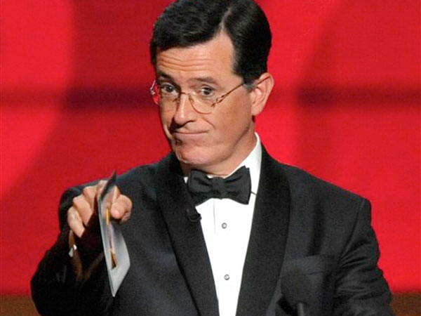 FILE - In this Sept. 23, 2012 file photo, Stephen Colbert presents an award onstage at the 64th Primetime Emmy Awards at the Nokia Theatre in Los Angeles. South Carolina Gov. Nikki Haley appears to have closed the door on appointing Colbert to the U.S. Senate, all because he didn´t know the state drink was milk. (Photo by John Shearer/Invision/AP, File)