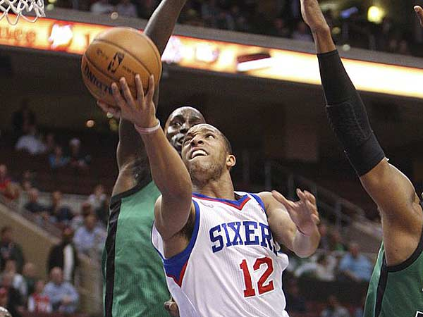 Evan Turner goes up between Celtics&acute; Kevin Garnett (left) and<br />Paul Pierce during the first quarter. (Steven M. Falk/Staff Photographer)