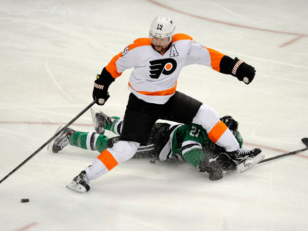 Flyers left wing Scott Hartnell (19) goes after the puck over Dallas Stars left wing Antoine Roussel (21) in the third period during an NHL hockey game, Saturday, Dec. 7, 2013 in Dallas. Dallas Stars won 5-1. (Matt Strasen/AP)