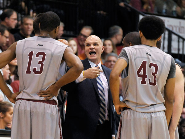 Saint Joseph's head coach Phil Martelli talks to his team during the second half of an NCAA college basketball game against Villanova on Saturday, Dec. 7, 2013, in Philadelphia. Villanova won 98-68. (Michael Perez/AP)