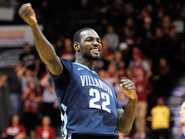 Villanova's JayVaughn Pinkson (22) celebrates after he scores basket and gets fouled during the second half of an NCAA college basketball game against Saint Joseph´s on Saturday, Dec. 7, 2013, in Philadelphia. Villanova won 98-68. (Michael Perez/AP)