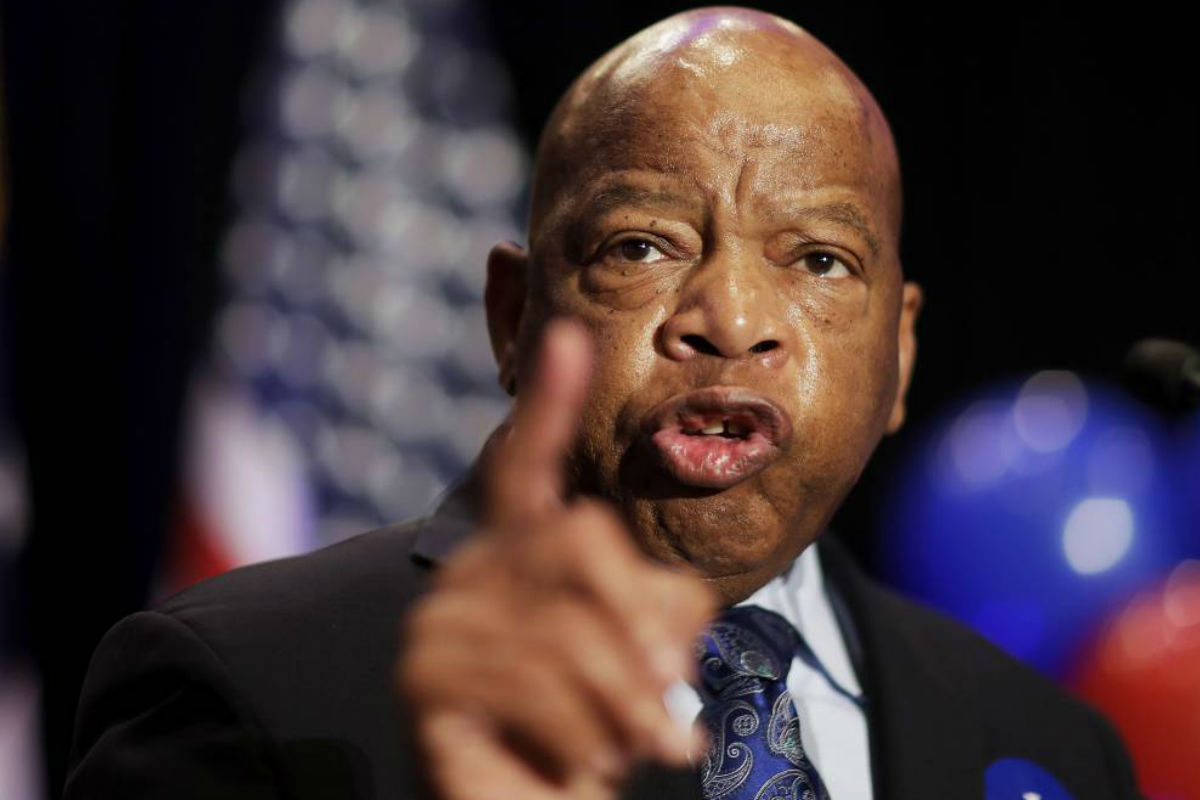 "FILE- In this June 20, 2017 file photo, Rep. John Lewis, D-Ga., speaks at an election night party for Democratic candidate for 6th congressional district Jon Ossoff in Atlanta. Lewis announced Thursday, Dec. 7 that he won´t speak at the opening of Mississippi civil rights and history museums on Saturday, saying it´s an ""insult"" that President Donald Trump will attend."