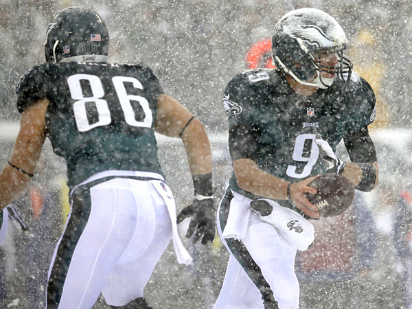 Eagles quarterback Nick Foles (right) in action during the first half against the Lions. (Michael Perez/AP)