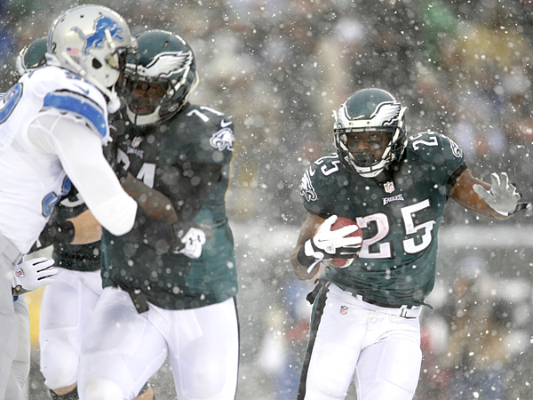 Eagles running back LeSean McCoy runs with the ball during the second half against the Lions. (Michael Perez/AP)