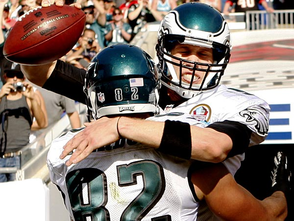 Eagles quarterback Nick Foles celebrates his touchdown run in the second quarter with Clay Harbor. (Ron Cortes/Staff Photographer)