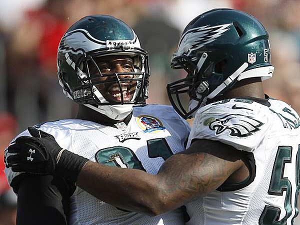 Fletcher Cox (left) celebrates with Trent Cole (right) as after the Cox sacked the Buccaneers´ Josh Freeman in the second quarter. (David Maialetti/Staff Photographer)