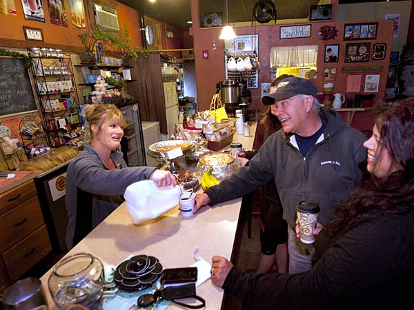 At the Barrington Coffee House, Colleen Ferraro serves (from left) Janine Sadowski, Ralph Gallo, and Renee<br />Coppola.