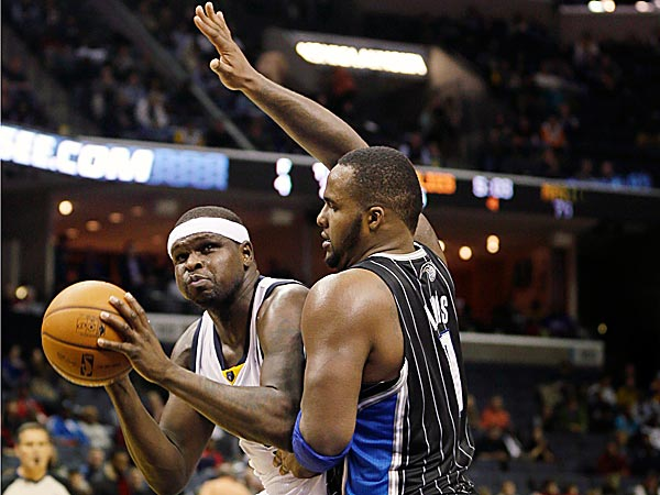 The Grizzlies´ Zach Randolph is defended by the Magic´s Glen Davis. (Danny Johnston/AP)