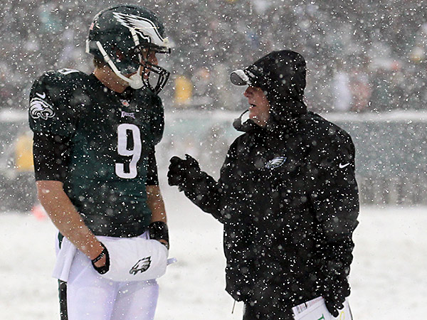 Eagles quarterback Nick Foles gets some advice from head coach Chip Kelly.