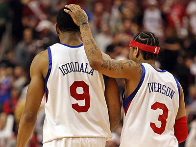 Philadelphia 76ers´ Allen Iverson consoles teammate Andre Iguodala after at last night´s game. (Steven M. Falk / Staff Photographer)