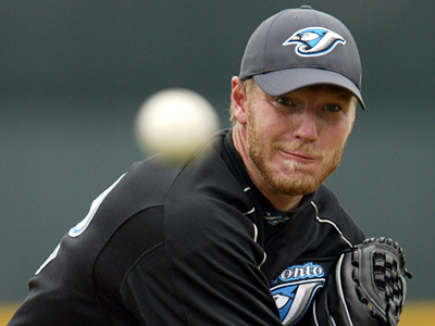 Toronto Blue Jays pitcher Roy Halladay is unlikely to land in Philadelphia, according to Phillies GM Ruben Amaro. (AP Photo/Kathy Willens)