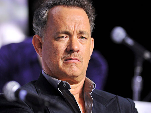 """Actor Tom Hanks listens during the press conference for the film """"Cloud Atlas"""" during the 2012 Toronto International Film Festival in Toronto on Sunday, Sept. 9, 2012. (AP Photo/The Canadian Press, Aaron Vincent Elkaim)"""
