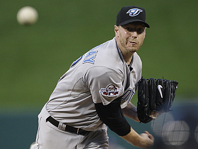 A reported blockbuster three-way trade would bring Roy Halladay to Philadelphia and send Cliff Lee to Seattle. (Morry Gash/AP file photo)