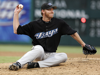 Is pitcher Roy Halladay worth the price the Phillies have to pay to acquire him? (AP Photo/David Pellerin)