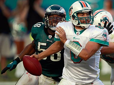 Trent Cole sacks Dolphins quarterback J.P. Losman in the fourth quarter. (David Maialetti/Staff Photographer)