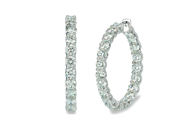Diamond studded hoops your lady will love.