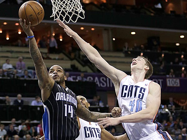 The Magic´s Jameer Nelson shoots against the Bobcats´ Cody Zeller and Ramon Sessions. (Chuck Burton/AP)
