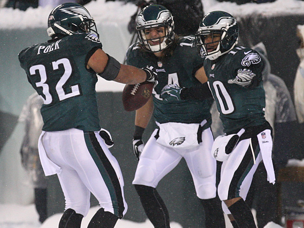 Chris Pol (left) celebrates his touchdown against the Lions with Riley Cooper (center) and DeSean Jackson (right). (Yong Kim/Staff Photographer)