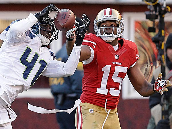 Seahawks cornerback Byron Maxwell intercepts a pass intended for 49ers wide receiver Michael Crabtree. (Ben Margot/AP)