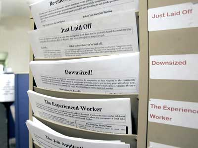 A rack with forms to assist the unemployed and job seekers is seen at a New York State Department of Labor career center in Albany, N.Y. The government says new claims for unemployment benefits reached their highest level in 26 years last week, as companies cut workers at a rapid pace. (Mike Groll/AP Photo, File)