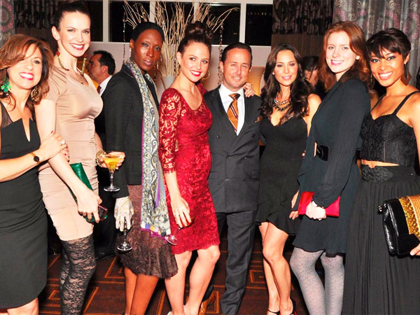 Josie Maran & John Colabelli (Publisher, Philadelphia Style Magazine) with her QVC models at Philadelphia Style´s holiday issue launch party held at Hotel Monaco on Dec. 11, 2012. (Al For / Philly.com)