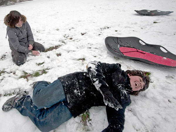 Haddon Heights 14-year-olds Lily Stark (left) and Gabe Lipko frolic in the snow, which accumulated to up to 5 inches in the region Monday.