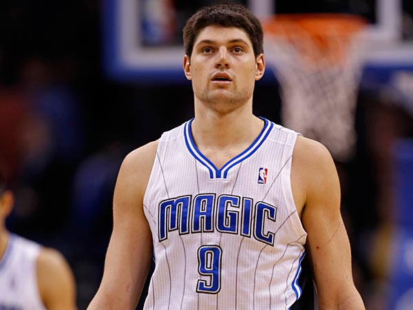 Orlando Magic center Nikola Vucevic (9) of Montenegro walks down court against the Utah Jazz during an NBA basketball game, Sunday, Dec. 23, 2012, in Orlando, Fla. (AP Photo/Scott Iskowitz)