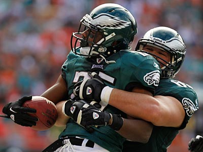 Danny Watkins picks up LeSean McCoy after his second touchdown on Sunday. (Ron Cortes/Staff Photographer)