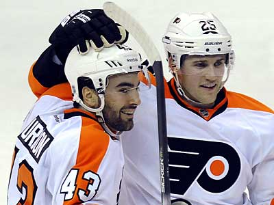Marc-Andre Bourdon, left, celebrates his team´s second goal with teammate Matt Carle. (AP Photo/Richard Lipski)