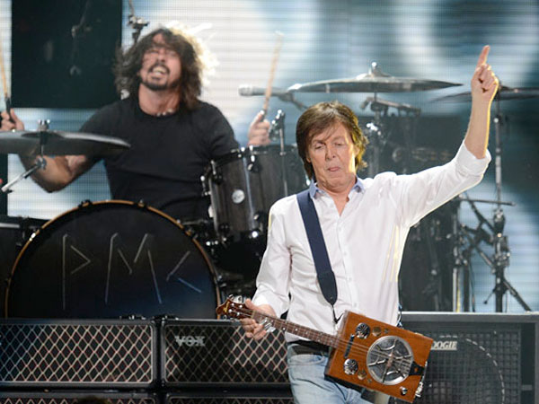 Dave Grohl, background, with Paul McCartney.