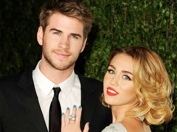 Liam Hemsworth with his fiancee, Miley Cyrus.