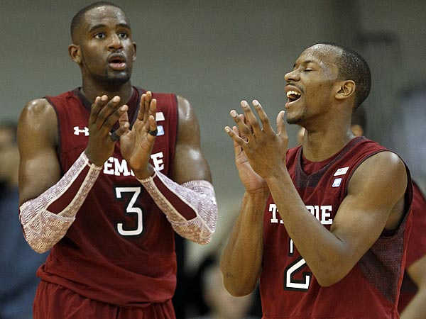 Temple´s Will Cummings (right) and Anthony Lee clap. (Yong Kim/Staff Photographer)