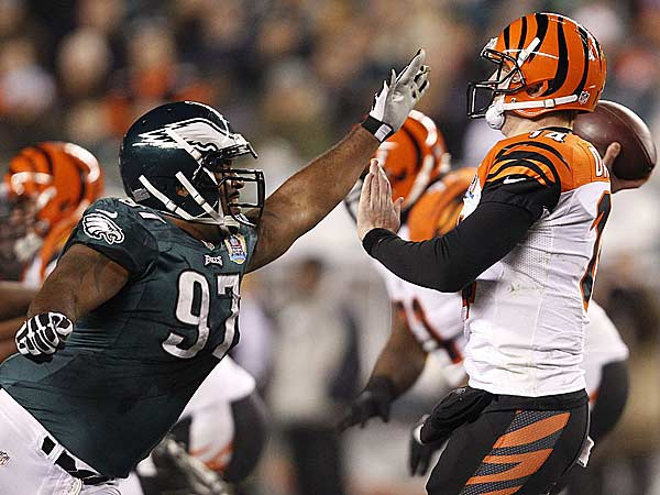 Cullen Jenkins (left) pressures Bengals quarterback Andy Dalton (right) during the first quarter. (David Maialetti/Staff Photographer)