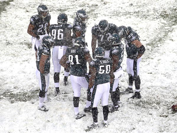 The Eagles huddle during the second half against the Lions. (AP Photo/Matt Rourke)