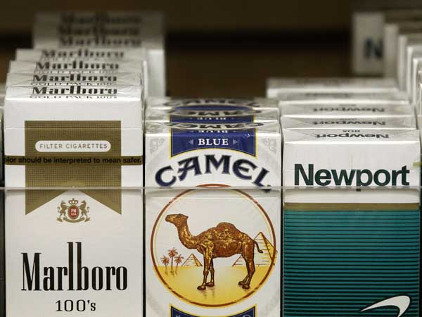Packs of cigarettes waiting to be purchased at a news stand. (AP Photo/Charles Rex Arbogast)