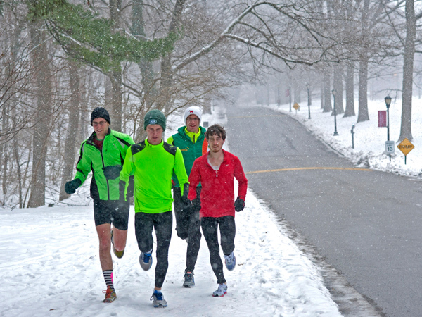 Haverford track team members run in the snow at the college on Dec. 14, 2013. They are, from left to right: Avi Bregman; Jimmy Gorman; Joel Christian; and Elliott Schwartz. (APRIL SAUL/Staff)
