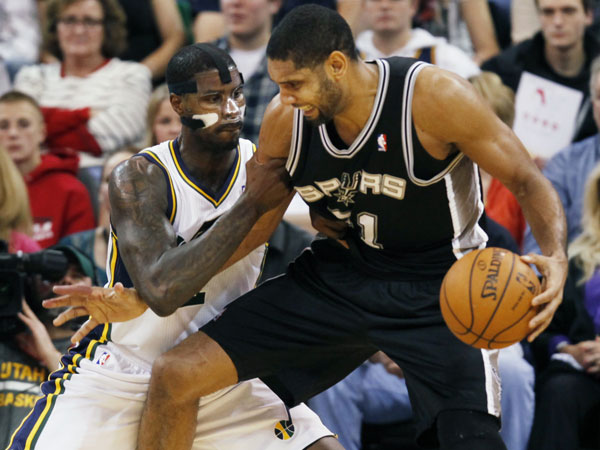 Tim Duncan, right, looks for an opening as Utah Jazz´s Marvin Williams, left, defends in the second half of an NBA basketball game on Saturday, Dec. 14, 2013, in Salt Lake City. San Antonio won the game 100-84. (Kim Raff/AP)