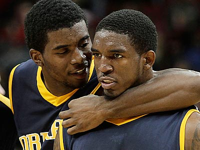 Gerald Colds (right) scored 20 points to lead Drexel to an upset of powerhouse Louisville. (Garry Jones/AP)