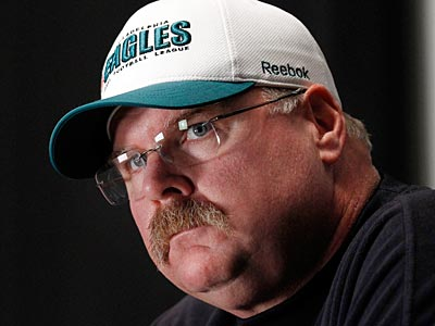 Andy Reid says the Eagles are happy with Michael Vick at quarterback. (Alex Brandon/AP file photo)