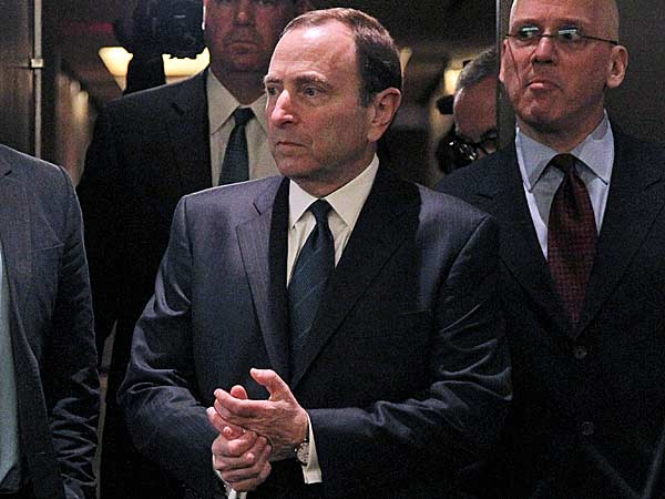 NHL commissioner Gary Bettman, center, arrives to speak with reporters after an NHL Board of Governors meeting, Wednesday, Dec. 5, 2012 in New York. The NHL and NHL Players´ Association have cleared their schedules with progress being made in collective bargaining talks. (Mary Altaffer/AP)